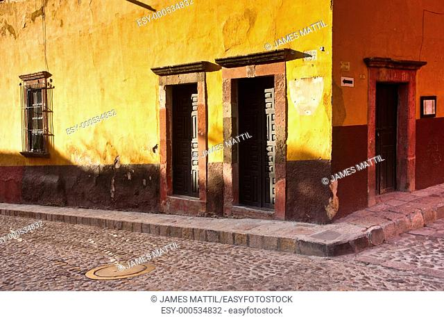 A colorful street scene in romantic colonial Mexico