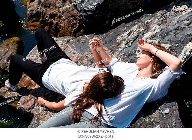 Best friends relaxing on rocks