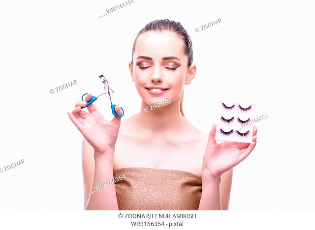 Woman in beauty concept applying make up using cosmetics