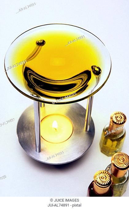 View of a candle in an oil burner