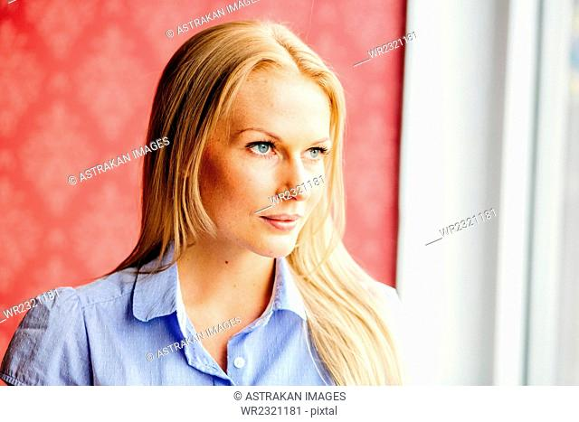 Thoughtful businesswoman looking away in office
