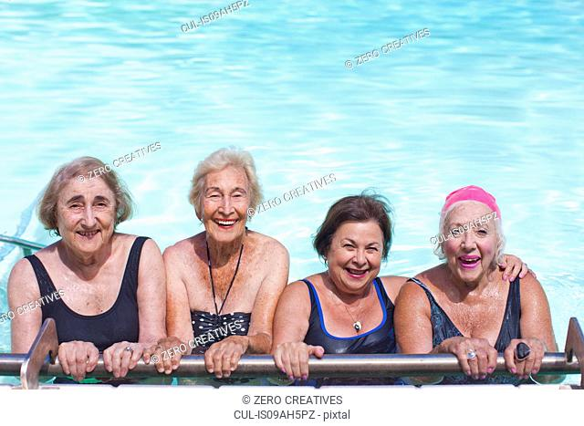 Portrait of four senior women in swimming pool