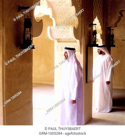 Men entering a mosque for praying