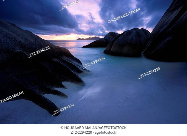 Landscape view of a colourful twilight on the famous Anse source d'Argent beach. La Digue Island, Seychelles
