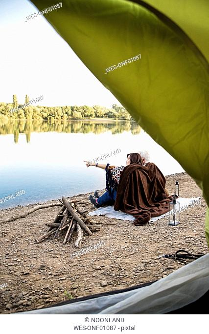 Senior couple camping at a lake