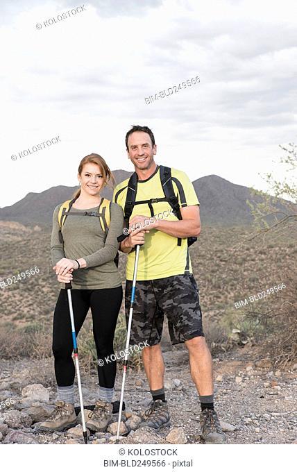 Portrait of smiling couple hiking in desert