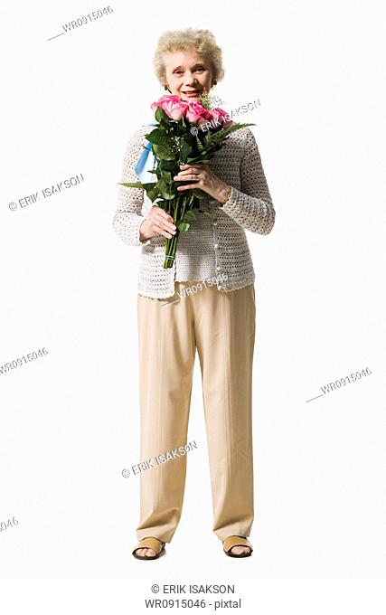Older woman with a bouquet of pink roses