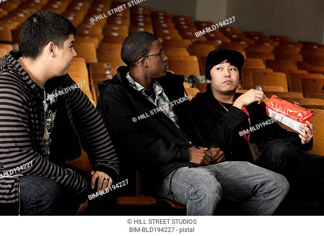 Students sitting in high school auditorium
