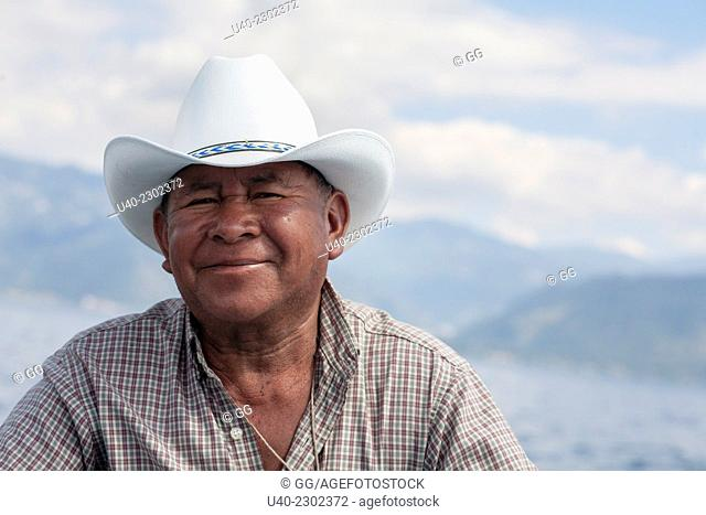 Mayan man wearing cowboy hat