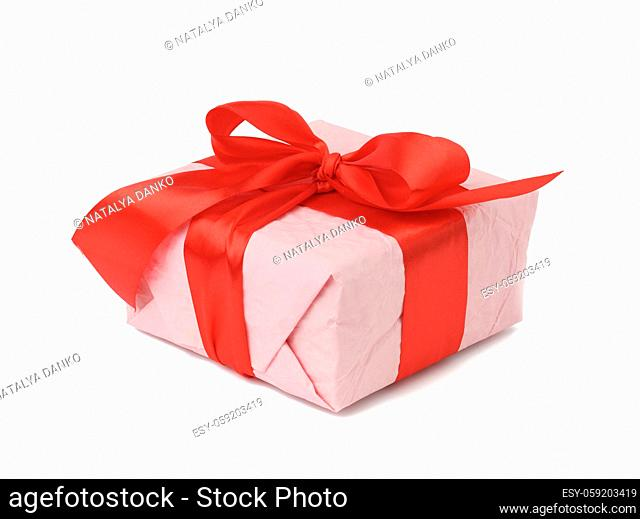 rectangular box wrapped in pink paper and tied with a red silk ribbon on a white background, celebration
