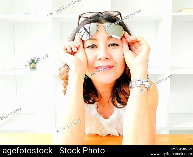 Beautiful Woman Covering Face Under Glasses