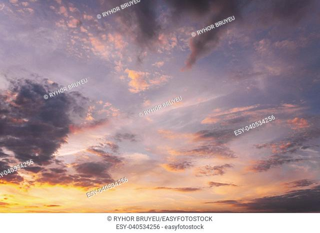 Sunset Sunrise Sky Background. Natural Bright Dramatic Sky In Sunset Dawn Sunrise. Yellow, Magenta, Purple And Pink Colors