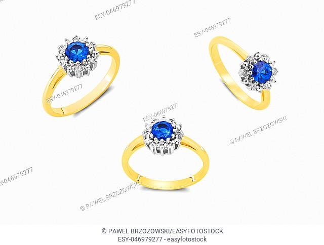 Gold rings with blue sapphires isolated on white background