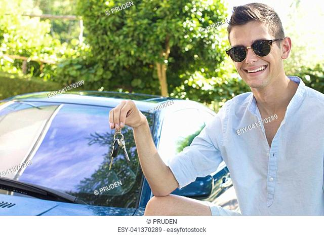young man with the keys to the car