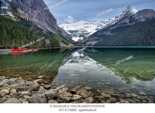 Glassy Smooth Lake Louise on a Fall Morning in Banff National Park Alberta Canada