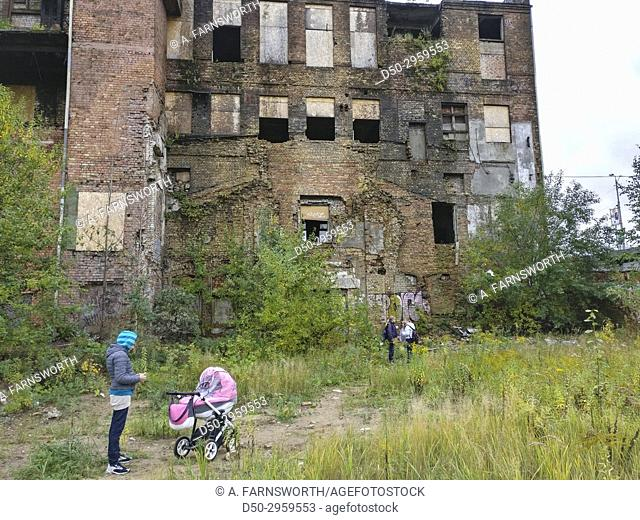 Riga, Latvia Kids exploring old abandoned factory after school