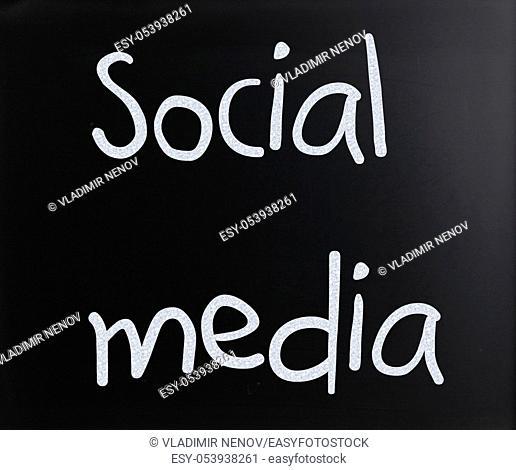 """""""""""""""""""""""Social media"""""""" handwritten with white chalk on a blackboard"""