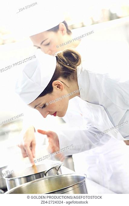 Women working in restaurant kitchen