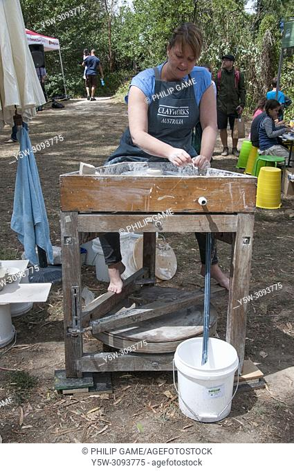 A female potter demonstrating her craft at a weekend exhibition at Warrandyte, Melbourne, Australia