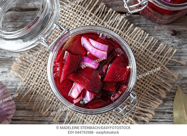 Preparation of fermented beet kvass in a jar, top view
