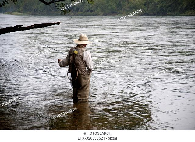 Man fly fishing at lake Taneycomo in Branson, Missouri
