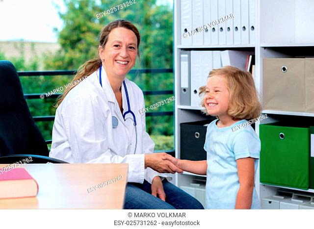 female pediatrician in white lab coat and the little patient