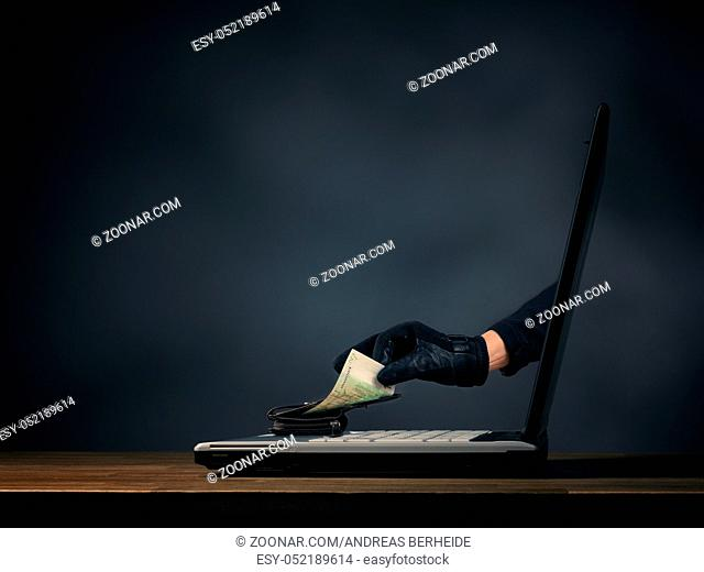 Cyberterrorism or hacking concept image, with laptop and hands with leather gloves