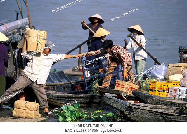 Market people do on a river in the Mekong delta near the city of Can Tho in sueden from Vietnam in southeast Asia