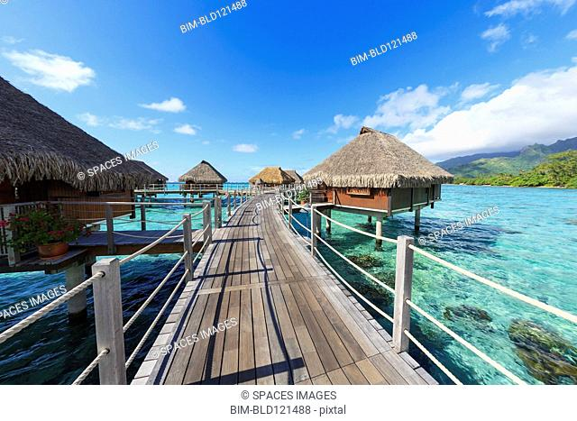 Decks connecting bungalows over tropical ocean, Bora Bora, French Polynesia