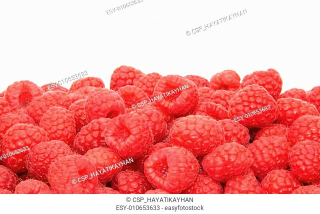 Fresh delicious raspberries on white background