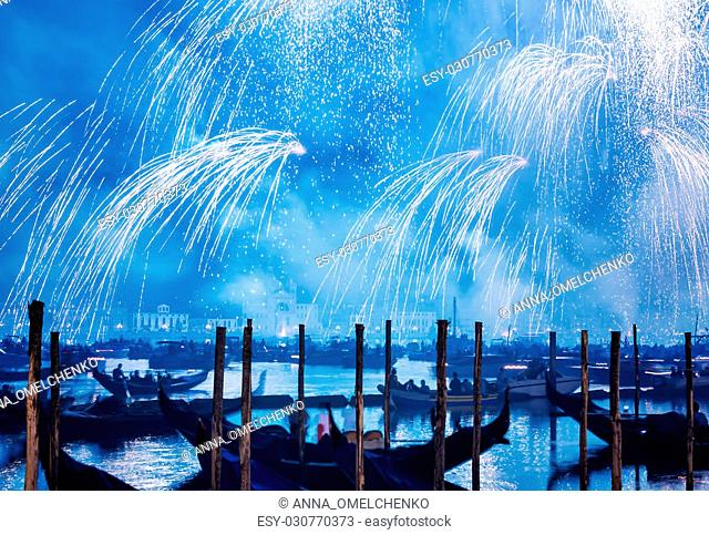 Redentore holiday, Redeemer festival of fireworks, beautiful blue salute over water, traditional celebration, tourism and travel to Venece, Italy