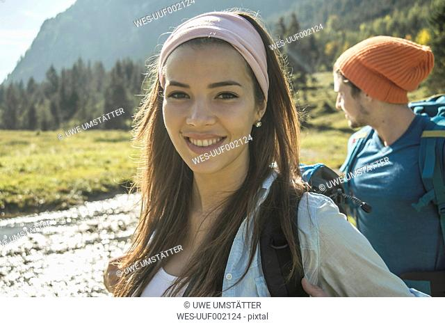 Austria, Tyrol, Tannheimer Tal, portrait of happy young female hiker