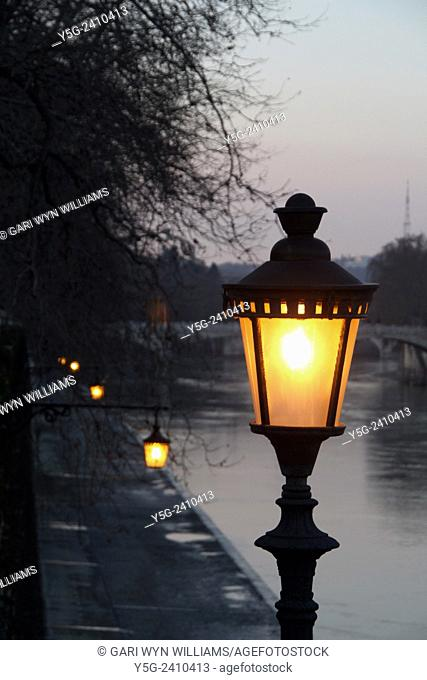 Street lamp on ponte sisto bridge by the tiber river in trastevere rome italy