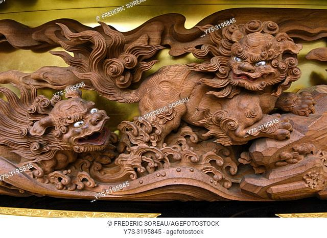 A detail of a dragon motif on a traditional wooden float at the Takayama festival in Japan, Asia