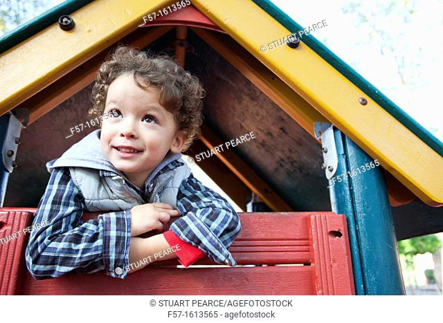 3 year old boy playing in a playground