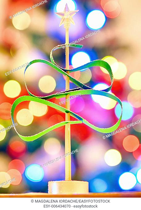 green Christmas tree made from paper on lights background