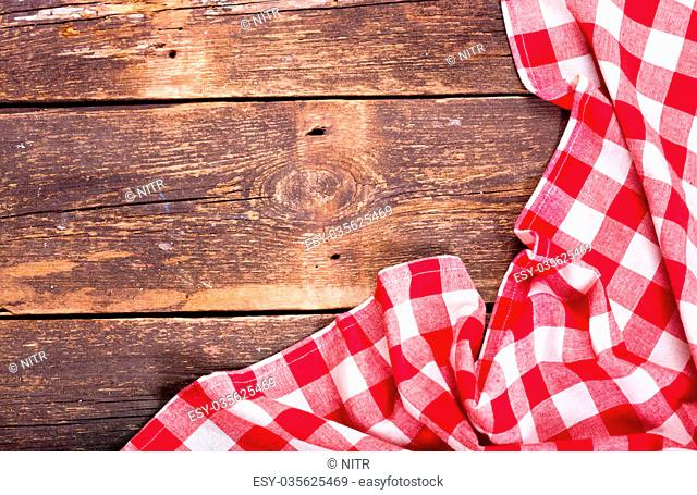 red tablecloth on old wooden table