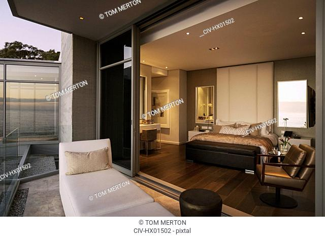 Modern luxury home showcase bedroom open to balcony