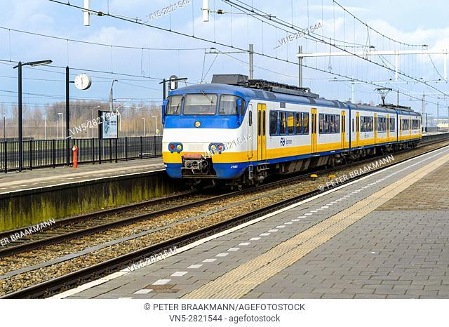 "LAGE ZWALUWE, THE NETHERLANDS â. "" JANUARY 29: Passenger train rides inside station to let passengers in and out on January 29, 2017"