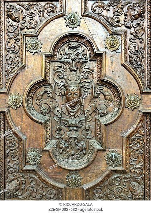 Italy, Lombardy, Valtellina, Tirano, Sanctuary of the Madonna di Tirano, Detail of the Carved Wooden Door.