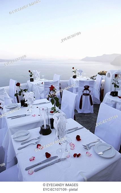 Tables set for dinner in an outdoor restaurant