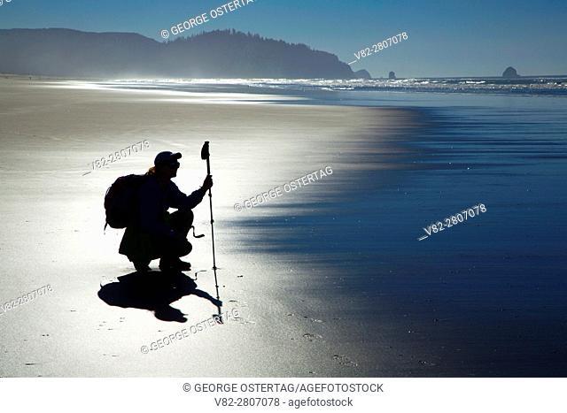 Beach hiker silhouette to Cape Meares, Bayocean Peninsula, Oregon