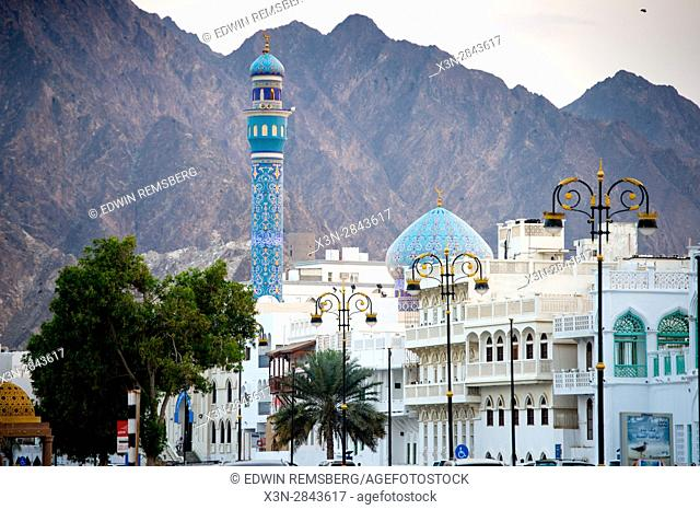 Mosque, mountains and city on the waterfront in Muscat, Oman