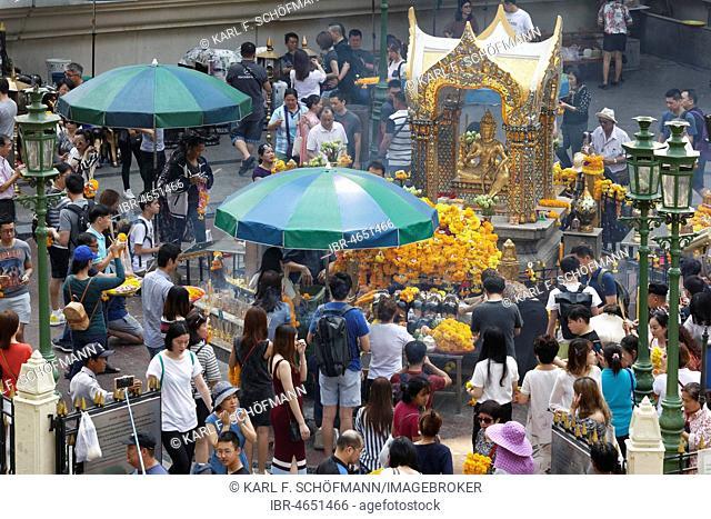 Many people at the Erawan Shrine with Hindu-God Brahma, Ratchaprasong crossing of Phloen-Chit- and Ratchadamri-Street, Pathum Wan, Bangkok, Thailand