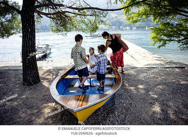 Children play on a boat, Lake Maggiore, Isola Bella, Italy