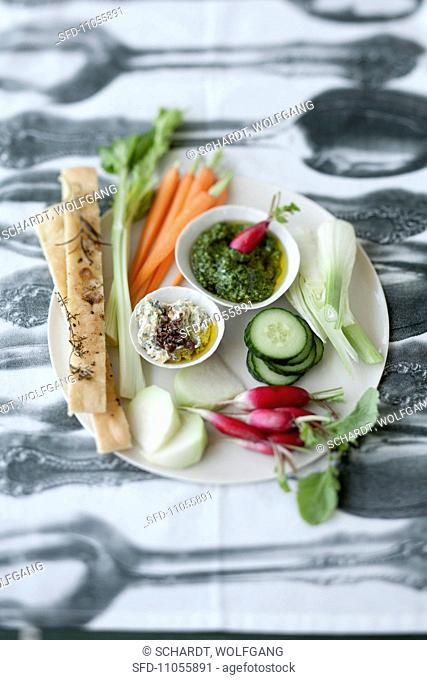 Raw vegetables with two dips and focaccia bread