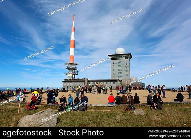 """19 September 2020, Saxony-Anhalt, Schierke: Visitors hike on the """"""""Brockenstraße"""""""" in the Harz Mountains. The sunny weather attracted numerous visitors to the..."""