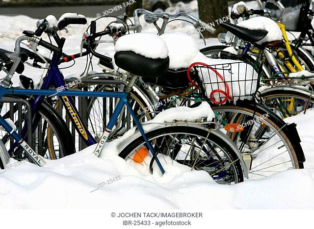 DEU, Germany, Munich : Snow covered bicycles