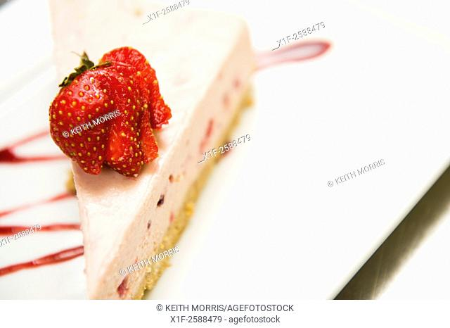 Plates of food (strawberry cheescake) at The Cross Foxes , 5 star luxury hotel and restaurant, near Dolgellau, Snowdonia National Park, Gwynedd, North Wales