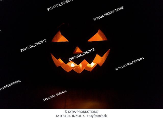 halloween jack-o-lantern burning in darkness